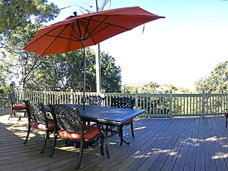 deck with chairs and table